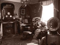 Living room/parlor with a Victrola, piano and fireplace