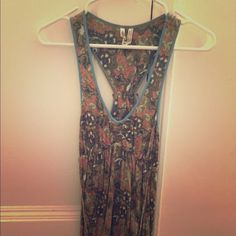 Free People Tank Comfortable stretchy tank, small tie in back. Olive green, blue, pink, and white. Free People Tops Tank Tops