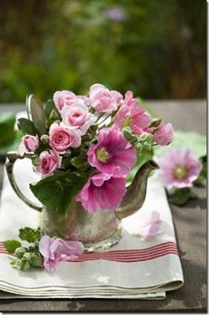 .Love this vintage pitcher full of posies and the linens too....