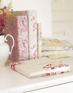 Use remnants of vintage fabric to cover handmade journals. Instructions: Fabric-Covered Journals   - CountryLiving.com