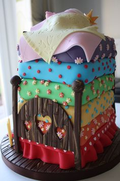 """This is the princess and the pea fairy tale cake I made for my daughter's 4th birthday. This picture shows the footboard of the bed. The mattress decoration was copied from another pinterest cake which I thought was wonderful (copying is apparently the sincerest form of flattery...). The cake toppers, board and bed designs are my own. I think this one took more than 100 hours to complete."""