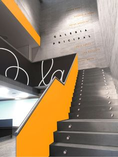 Successful use of color/ palette, dark yellow and shades of grey in a contemporary designed staircase.
