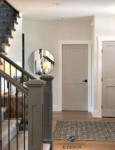 Entryway with Benjamin Moore Edgecomb Gray lightened, Revere Pewter painted doors, white trim, dark painting stair railing. Kylie M Interiors Edesign, online paint color consulting Interior Door Colors, Grey Interior Doors, Painted Interior Doors, Painted Doors, Interior Door Styles, Entryway Paint Colors, Diy Interior Painting, Farmhouse Interior Doors, Farmhouse Trim