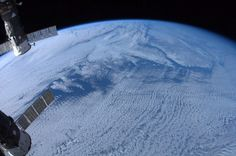 """Newfoundland and Labrador lie under clouds in a photograph made the from International Space Station by Canadian astronaut Chris Hadfield on January 7, 2012. (Chris Hadfield/NASA/Canadian Press/Associated Press)"""
