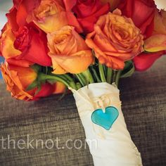 Katie's round bouquet of orange roses was wrapped in extra fabric from her dress, a Dogeared glass heart charm and her grandmother's wedding band.