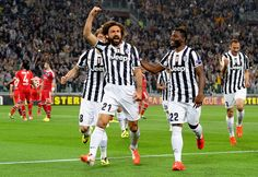 Andrea Pirlo of Juventus #21 celebrates scoring the first goal during the UEFA Europa League quarter final match between Juventus and Olympi...