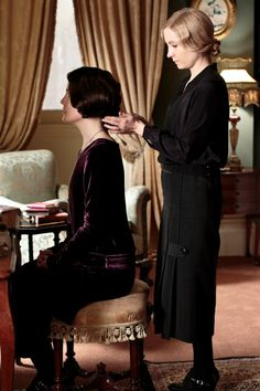 Lady Mary is attended to by Anna   ..rh