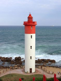 Umhlanga Rocks Lighthouse is located close to the Port of Durban, South Africa. This lighthouse was commissioned in 1869 and stands 21 meters above the beach. The Umhlanga Rocks Lighthouse has never had a keeper as the Oyster Box Hotel has been the official warden. The lighthouse controls are in the hotel office where staff monitor the controls and report to Portnets Lighthouse Service.