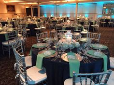 Mint and navy east coast wedding. Blush tones with white hydrangeas, navy colored thistle and gray dusty miller. Reception tables with beautiful lantern centerpieces. Snowberrystudio.com
