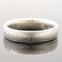 arn krebs mokume gane mens jewelry wedding band in sterling silver and white gold Custom Wedding Rings, Wedding Bands, Wave Ring, Wave Pattern, Rings For Men, White Gold, Engagement Rings, Jewelry, Sterling Silver