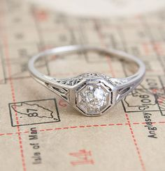 Winged Filigree Engagement Ring, $1350