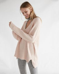 Nothing beats cozying up in a big tunic sweater on a cold day, and this one's roomy shape, deep v-neck and hi-lo hem will make it a fast favorite this season. Dress it up or down, and wear it everywhere.