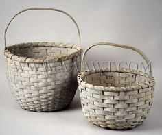 As depicted, in very good condition, with carved handles and in a soft gray-blue paint with dry patina.  Dimensions: 16.5-inch height to larger basket's handle, 11.75-inch height to smaller basket's handle.  $995  912-88