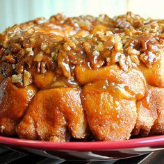 Apple Cinnamon Monkey Bread Recipe adapted from Whats Cookin' Chicago, originally adapted from Paula Deen  1/4 cup sugar 2 tsp cinnamon 3 cans refrigerated biscuits (I use the Pillsbury Buttermilk biscuits that come in a 4 pack) 2 large apples, diced (I used Gala) 1/2 cup unsalted butter, plus more for buttering pan  1 cup packed light brown sugar 1/2 tsp vanilla extract 1/2 cup chopped pecans