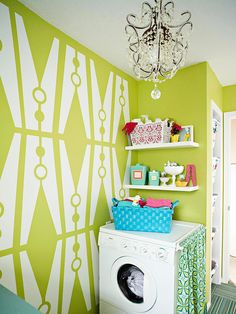 A colorful makeover turned this laudry room into an exciting space. See the rest of it here: http://www.bhg.com/rooms/laundry-room/makeovers/colorful-laundry-room-makeover/?socsrc=bhgpin080612colorfullaundryroomredo#page=8