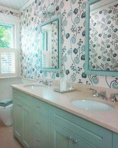 Tiffany blue bathroom cabinets love the wallpaper
