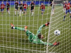 Manchester United's goalkeeper David de Gea, is unable to save a shot by CSKA's Seydou Doumbia during the Champions League Group B soccer match in Moscow, Russia.  Pavel Golovkin, AP