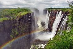 Rainbow over Victoria Falls on Zambezi River, border of Zambia and Zimbabwe;Iguassu Falls on Argentina si...