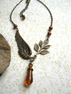 Angel wing necklace amber glass beads steampunk por botanicalbird