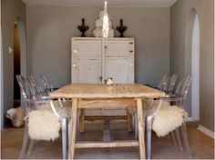 ghost chairs and faux sheepskin