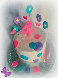 dots, flowers and butterflies cake