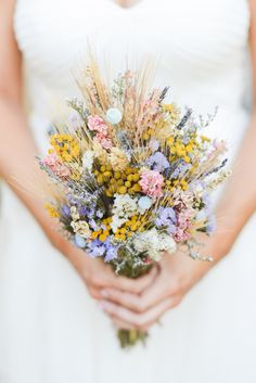 Craspedia, Dried Wheat and Wildflower Bouquet | Delaney Dobson Photography https://www.theknot.com/marketplace/delaney-dobson-photography-horsham-pa-850310