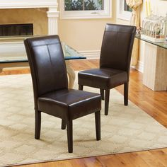 Sleek and stylish, these sumptuous brown leather dining chairs feature thick padded seats for lasting comfort.  With espresso-stained hardwood legs and clean lines, these chairs give your dining room a quick style update you'll appreciate.