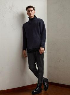 H&M Studio F/W 2016: Studio gilet, £19.99 Studio knitted sweater, £79.99 Studio trousers, £39.99 Studio boots, £119.99 [Model: Anders Hayward]