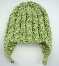 Baby Earflap Hat Knitting Pattern with cable design by LoveFibres