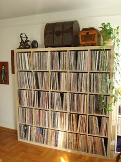 The Ikea Expedit shelves are a go-to source for handsome record storage — plus they're inexpensive. Source