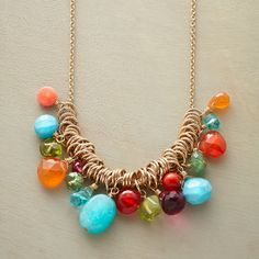 RIO NECKLACE -- Mixed gemstones of peridot, amazonite, turquoise, carnelian, pink coral, red coral, pink quartz,  teal quartz,apatite and jade grasp golden rings in a vibrant display of Brazilian effervescence. Handmade in USA by Dana Kellin. Dainty 14kt goldfill chain