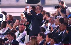 Frederik Crown Prince of Denmark takes a picture of the danish delegation during the opening ceremony of the 2016 Summer Olympics at Maracana Stadium...