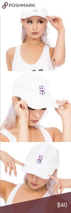 """10MILLION GRAM DAD HAT Taiwanese design duo Mary Jane Nite are often celebrated for their forward thinking take on unisex streetwear and minimal aesthetics.   The 10 Million Gram Dad Hat is gonna bring you fortune and prosperity! This dad hat features a godly white colored construction, an adjustable metal clasp on the back for a precise fit, and an embroidered """"Maneki-Neko"""" aka money cat holding a coin with the Chinese characters """"千万克"""" for 10 million gram. Mary Jane Nite Accessories Hats"""