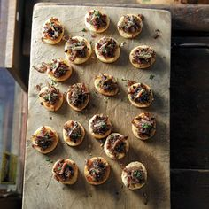Pissaladières (Onion and Anchovy Tarts) by Saveur. Based on the classic French caramelized-onion tart with olives and anchovies, these little two-bite hors d'oeuvres pack a flavorful punch. Anchovy Recipes, Onion Recipes, Tart Recipes, Appetizer Recipes, Seafood Recipes, Appetizer Ideas, Baking Recipes, French Appetizers, Holiday Party Appetizers