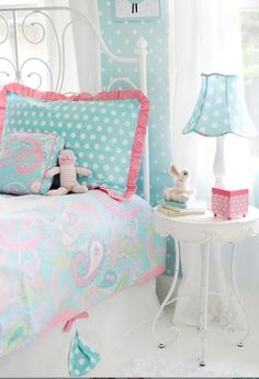 "Our full duvet features the fun paisley print with pink cording and white reverse, zipper closure. Includes 2 standard shams in aqua polka dot with a hot pink ruffle and a 17"" bed skirt constructed of white pique and accented with two aqua polka dot pleats tied with precious pink bow."