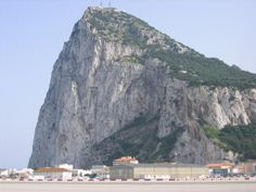 """The famous Rock of Gibraltar  This """"rock"""" still falls under England's control.  There are over 500,000 people living around this rock.  To get into the area you have to go through customs park your car and walk across the air-strip.  It is really strange standing by a walk/don't walk sign and watch an airplane land and then get the """"walk"""" signal to pass!  It is a beautiful city with very nice people."""