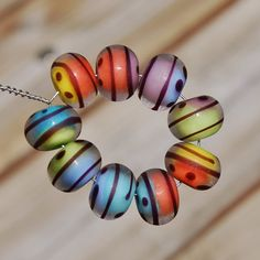 Silhouette  K O Lampwork Beads  Set of 9 Beads by koregon on Etsy, $28.00