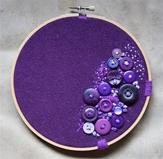Purple buttons and embroidery on purple fabric, in an embroidery hoop.  Sofi would love this one...
