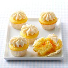Orange Dream Mini Cupcakes Recipe -The bright taste of these cute cupcakes reminds me and my friends of orange-and-vanilla frozen treats. —Jen Shepherd, St. Peters, Missouri