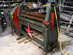 """Plate Roller by FabItUp -- Homemade 65"""" plate roller featuring hardened steel rollers. Powered by a 65 HP clutched motor via a cast gear set. Capable of rolling channels and mini beams. http://www.homemadetools.net/homemade-plate-roller-2"""