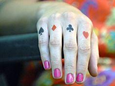 http://www.tatuagemfoto.net/tattoo-baralho-naipes-espadas-ouros-paus-e-copas/