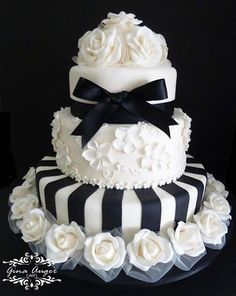 Tiered cake ... with white roses, black stripes and a black bow! FROM: https://fbcdn-sphotos-h-a.akamaihd.net/hphotos-ak-ash3/p480x480/1012789_606003742764686_425592732_n.jpg