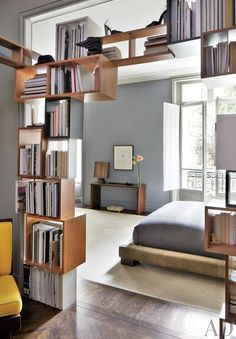 Love this bookshelf! Stefano Pilati's Paris Duplex Apartment Renovation : Architectural Digest