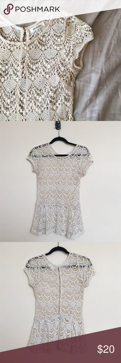 Crotchets Peplum Top Beautiful with button detail up the back - so cute with a bright or soft color tank underneath! The only flaw is one small discoloration (pictured) but completely unnoticeable when wearing :)  🍍 No low ball offers  🍍 No modeling - if it fit I would have already posted a picture  🍍 POSH ONLY Monteau Tops Blouses