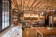 Kitchen & sitting area of a renovated warehouse in DC - Exposed brick and wood ceiling beams - Eclectic decor - Bennett Frank McCarthy Architects Inc. Small Cottage Interiors, Cottage Homes, Rustic Interiors, Eclectic Kitchen, Eclectic Decor, Dining Area, Kitchen Dining, Brick And Wood, Built In Cabinets