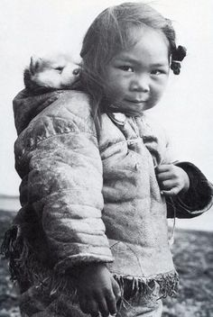 Little Inuit girl and her husky, by Richard Harrington, 1950.