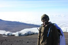 Tour Leader Jimmy still smiling on the slopes of Kilimanjaro. Mount Kilimanjaro, Tanzania, Trekking, Climbing, Africa, Tours, Explore, Adventure, Mountains