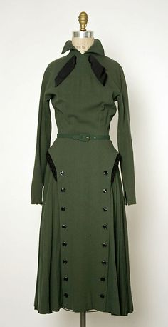 Green wool dress with black buttons, ribbon, and fur trim, by Jacques Fath, French, 1949.