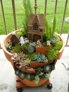 Don't throw away those broken pots try this Little garden made with broken pots.