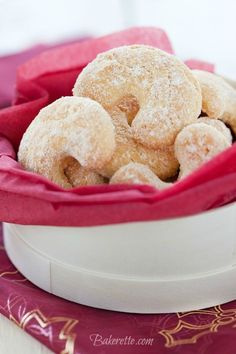 Vanilla Cookies ~  These cookies are an Austrian delight called Vanillekipferl. They are made with finely ground almonds, shaped into crescents, and covered in powdered sugar!  Recipe @: http://bakerette.com/vanilla-cookies/